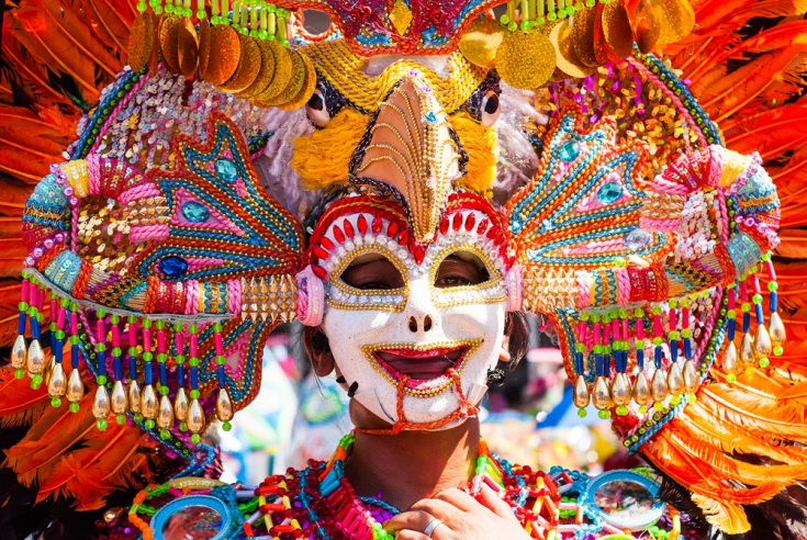 36176846 - masskara festival performer wearing bird mask