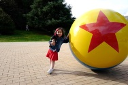 Scarlet poses by the Pixar ball at the Pixar Animation Studios in Emeryville, California