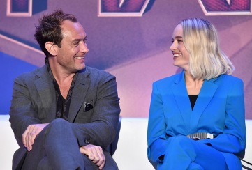 """BEVERLY HILLS, CA - FEBRUARY 22: Actors Jude Law (L) and Brie Larson speak onstage during Marvel Studios' """"Captain Marvel"""" Global Junket Press Conference at The Beverly Hilton Hotel on February 22, 2019 in Beverly Hills, California. (Photo by Alberto E. Rodriguez/Getty Images for Disney) *** Local Caption *** Jude Law; Brie Larson"""
