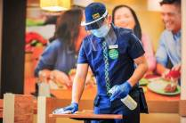 A designated Mang Inasal Hygiene Ambassador reminds the store team to wash their hands every hour and sanitize every 30 minutes. He also conducts the cleaning and disinfection of the dining tables after every use.