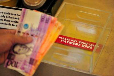 For customers opting to do cash payments, trays are provided for contact-less transactions.